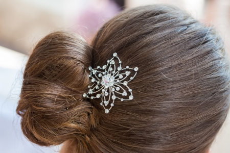 hairclip: The diamond hair clip in the hair of a woman.