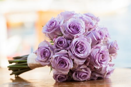blooming purple: Purple rose bouquet for the bride on her special day.