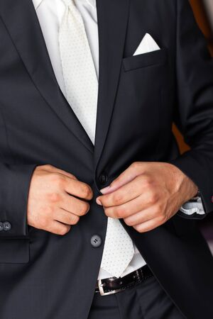 getting married: The groom is getting dressed for his big day. Stock Photo