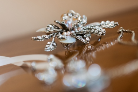 accessorize: Some diamond accessorize being photographed on a table.