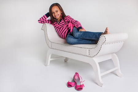 A younge very girly girl being photographed in the studio. photo