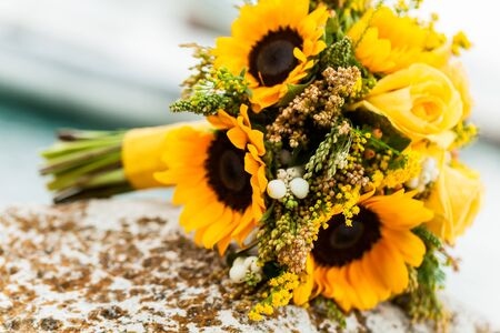 chose: The bride chose a yellow theme and bouquet for her wedding. Stock Photo
