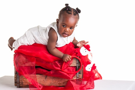 wooden crate: A little African baby laying in a wooden crate. Stock Photo