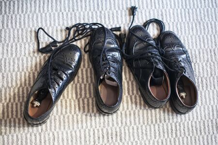 Two pairs of black men's shoes are on the floor. Stock Photo - 16350457