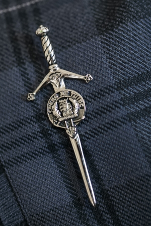 A unique silver pin on a men's navy, grey toga. Stock Photo - 16700739