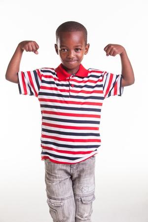 ストライプ ・ デニムを着た小さな男の子 写真素材