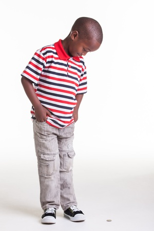 Little boy dressed in stripes and denim photo