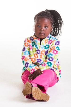 bored face: A young African girl in flowers sweater and pink jeans