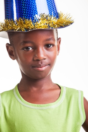 seven persons: A little boy with a sparkling hat on the head