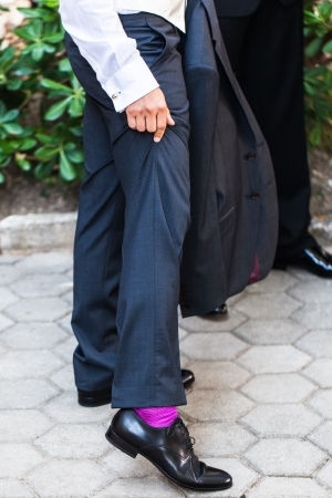 The groom with his unique socks for the wedding. photo