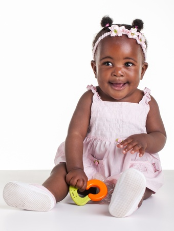 Little African girl are being photographed in the studio  photo