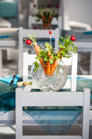 Carrot and berries ikebana decorations in a glass vase Stock Photo - 17223183