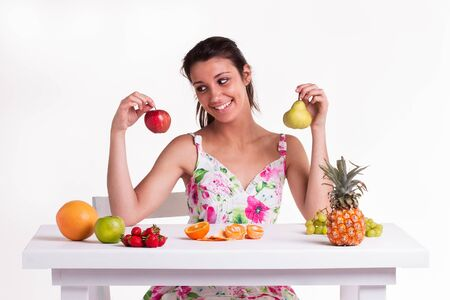 A yong model with a apple and pear in her hands Stock Photo - 17262935