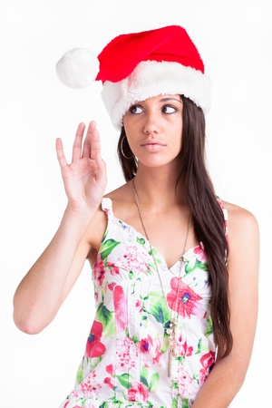 A young girl playing with the furry ball on her Christmas cap  Stock Photo - 17263037