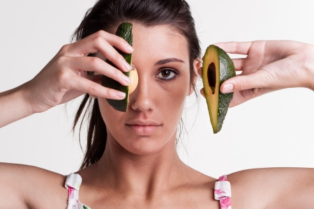 Close-up of a model with a avocado split in two Stock Photo - 17263035