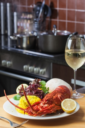 crayfish: A nice, big plate filled with lobster, rice and a glass of white wine  Stock Photo