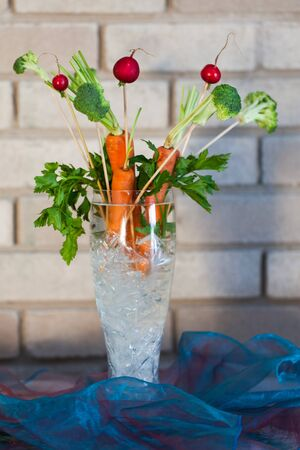obtained: Carrot and berries decorations in a glass vase.