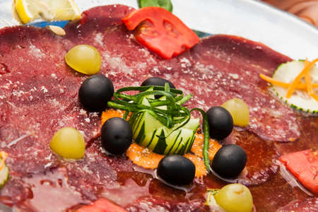 Starter platters with cheese, salami, beacon, eg. photo