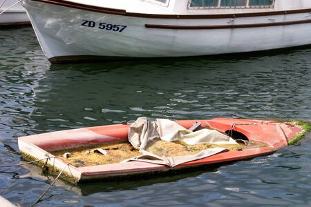 A sinking boat that were left behind. Stock Photo - 17579460