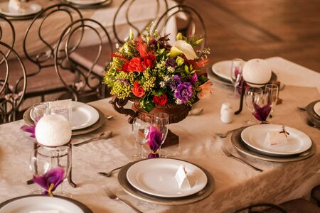 The center piece on the table consist mainly out of roses. photo
