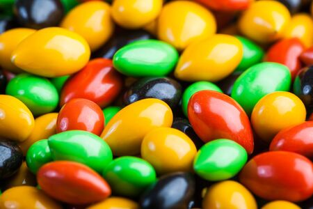 sweeties: A whole lot of Colourful sweeties with green, red, yellow and black colouring.
