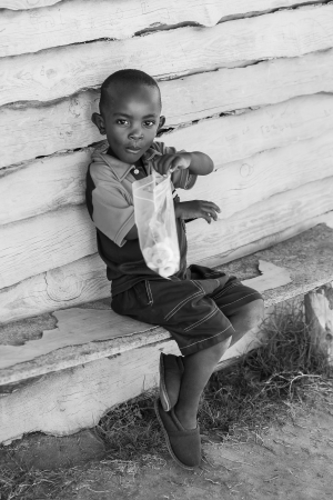 A young boy who is wiling to share his sweets.