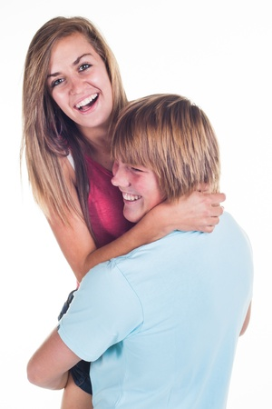 A young teenage couple playing around in the studio  photo