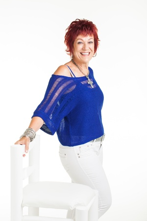 red haired person: A woman being photographed dressed in white and blue