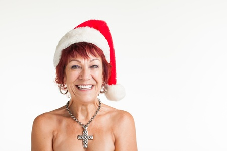 santa girl: A red head are getting photographed with a red christmas hoodie. Stock Photo