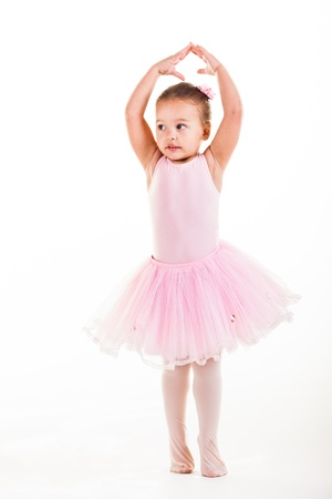 niño modelo: Una pequeña bailarina rosa de muy buen humor en el estudio. Foto de archivo
