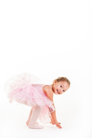 A little pink ballerina in  a playful mood in the studio.