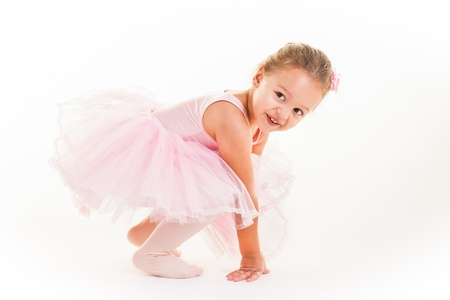 A little pink ballerina in  a playful mood in the studio. photo