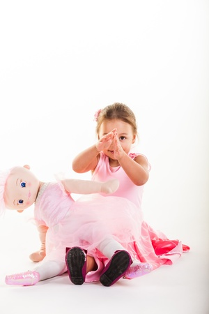 dance preteen: A little girl dressed in a pink fairy outfit in the studio.