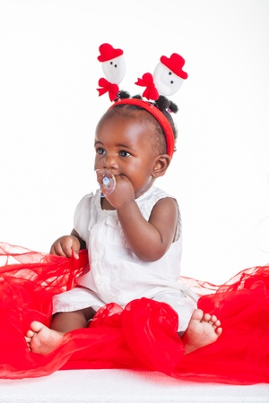 A 8 month old baby dressed to explore Christmas  Stock Photo - 20358997