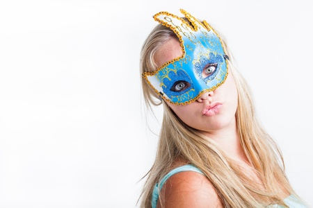 resemblance: A young blond girl dressed with a blue mask.