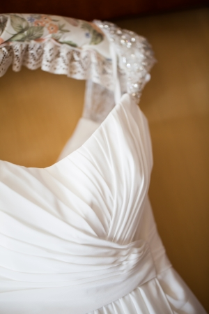 fancy dress costume: The top cut of the wedding dress of the bride.