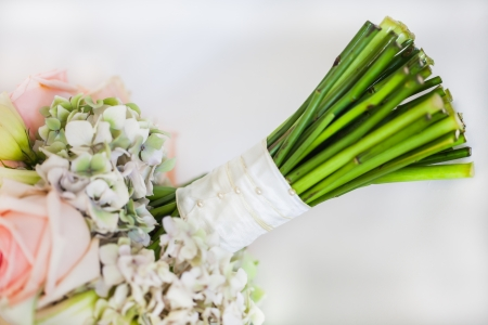 christamas: A bridal bouquet filled with light pink roses and some Christamas roses as well. Stock Photo