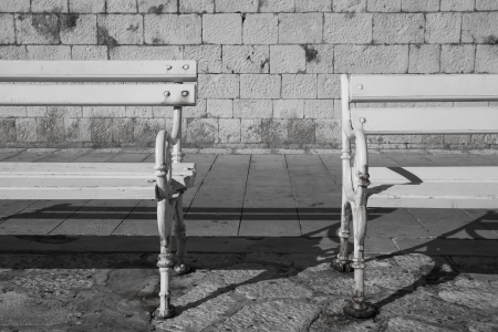 Two benches on the street in Croatia. photo
