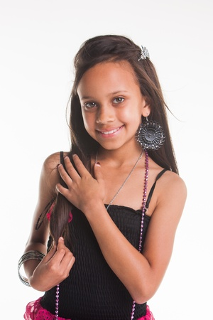 A Indian girl in the studio being photographed in different outfits. photo