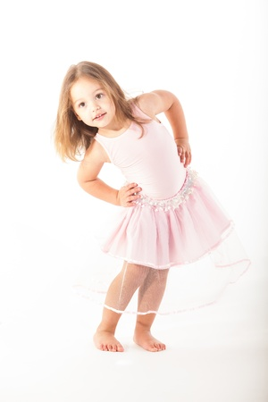 A little girl twirls and turns in her fairy outfit. photo