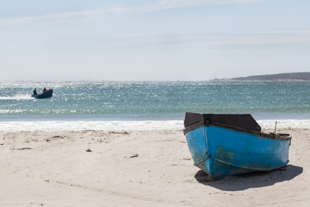 lovelorn: A boat wreck stranded on the shore of the Western Coast.
