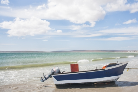 lovelorn: A boat stranded on the shore of the Western Coast.