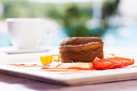 fallen fruit: A souffle served with pineapple and strawberries with coffee. Stock Photo