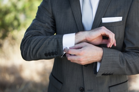 cuff links: The final touches for the perfect fit of his tuxedo. Stock Photo