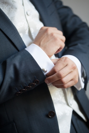 getting ready: The final touches for the perfect fit of his tuxedo. Stock Photo