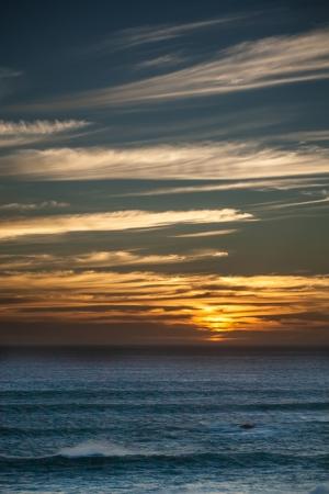 restless: golden sunset over the restless ocean Stock Photo