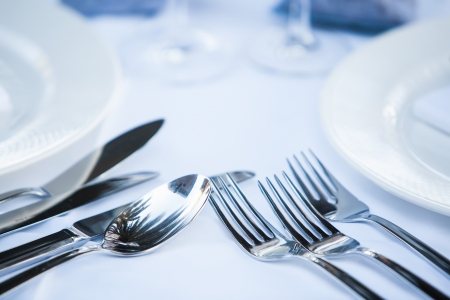 fine silver: close-up of fine silver cutlery on a white set table Stock Photo