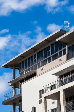 image of the top of a building with the bright blue skry in the background