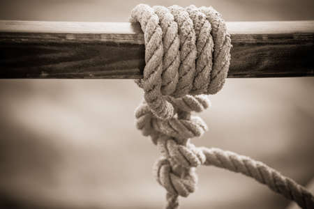 an image of a rope in a sail knot on a wooden bar