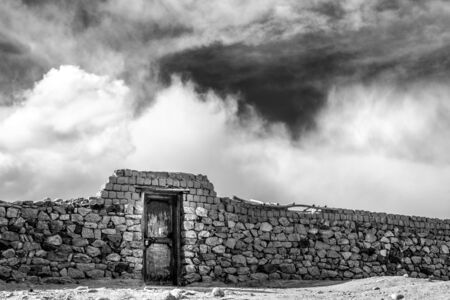 Abstract picture with stone wall and sky Stock fotó